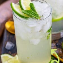 Mojito in a glass with recipe title on top of image