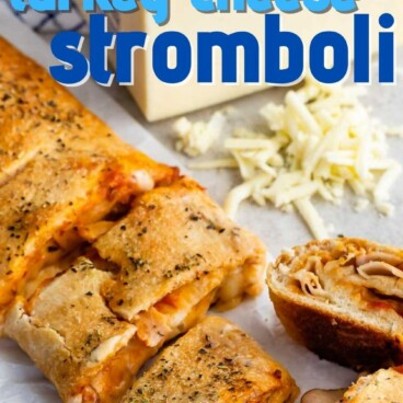 sliced Stromboli with block of Cooper cheese behind
