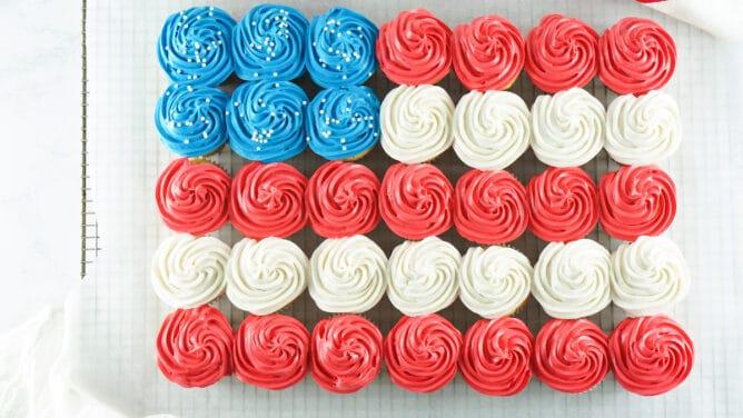 Overhead shot of american flag cupcake cake on metal cooling rack