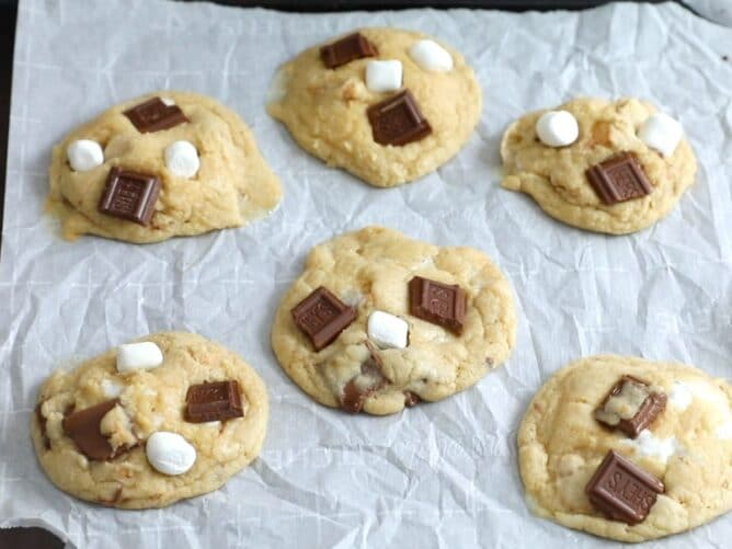 Six s'mores cookies on white parchment paper