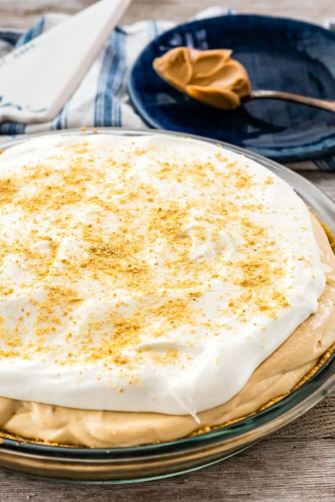 pie with cool whip on top and graham cracker crumbs