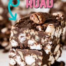 Three easy rocky road bars stacked on eachother with more in the background and recipe title on top of image