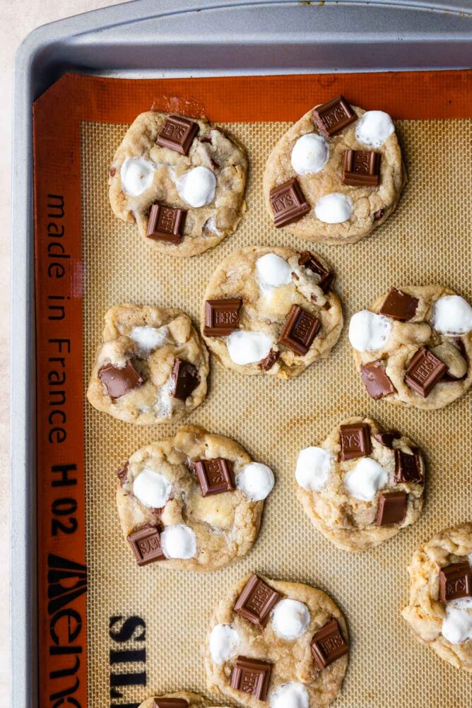 Overhead shot of s'mores cookies on a silicon baking mat fresh out of the oven