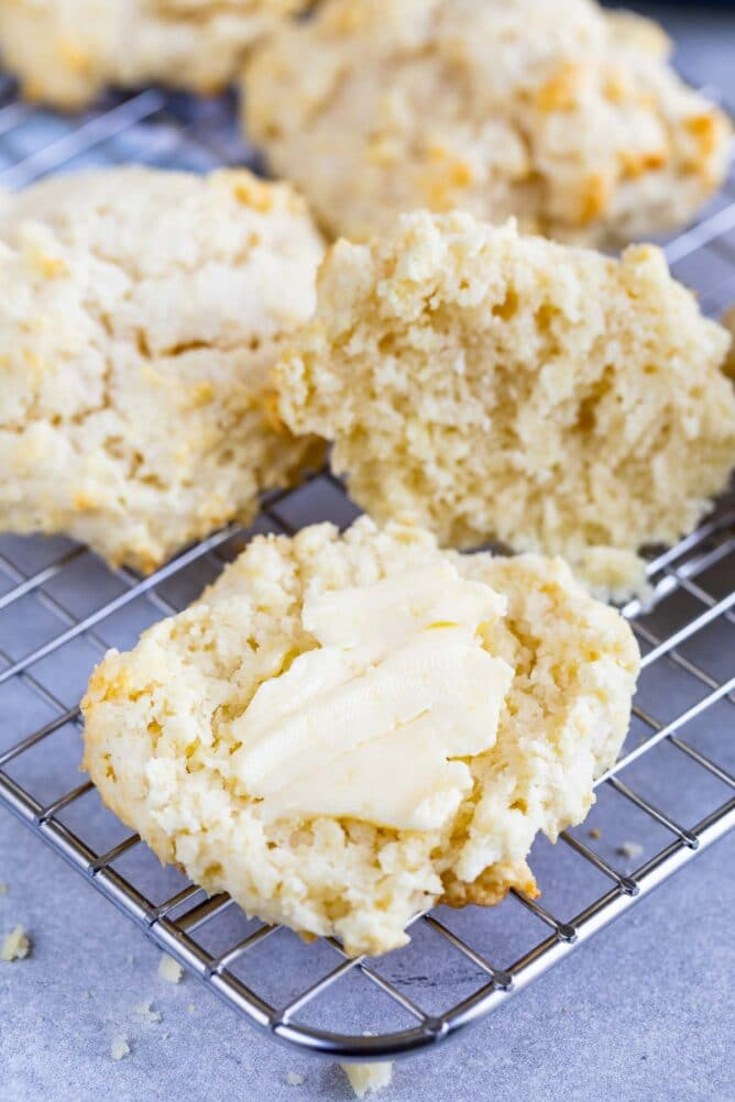 biscuit on rack cut open with butter