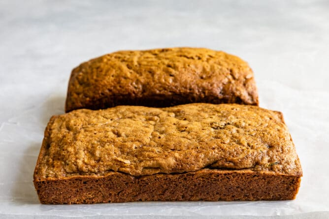 Two loaves of zucchini bread side by side