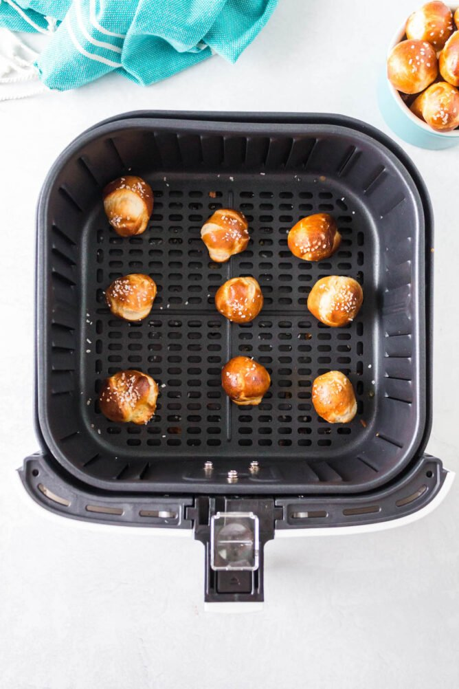 Overhead shot of baked pretzel bites in the air fryer tray