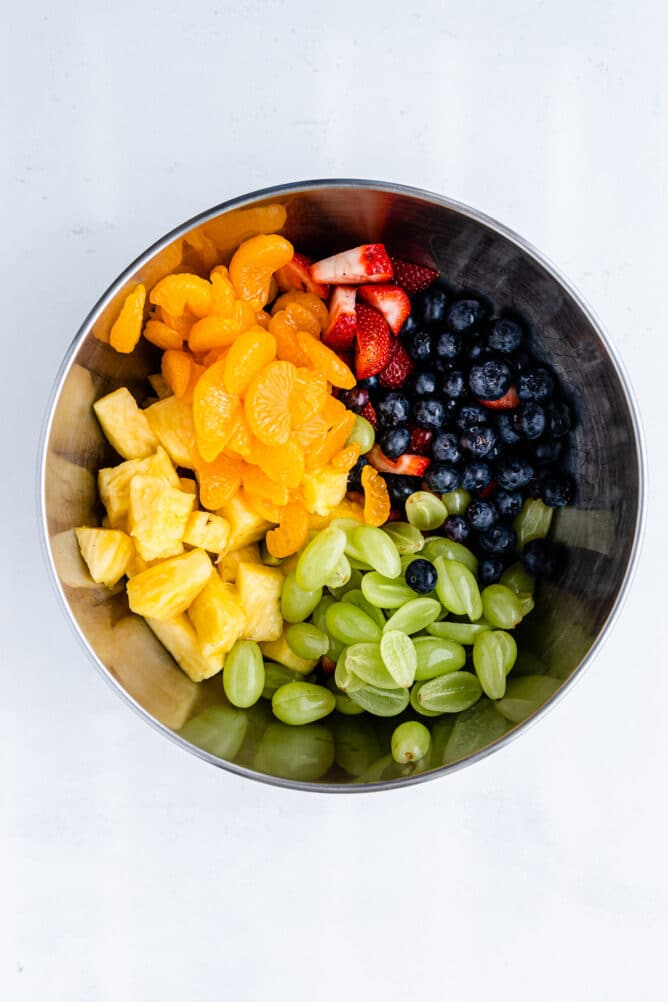 Overhead shot of all fruit together in one big bowl not mixed together