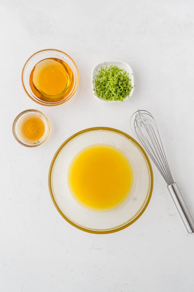 Overhead shot of all measured ingredients needed to make the fruit salad dressing