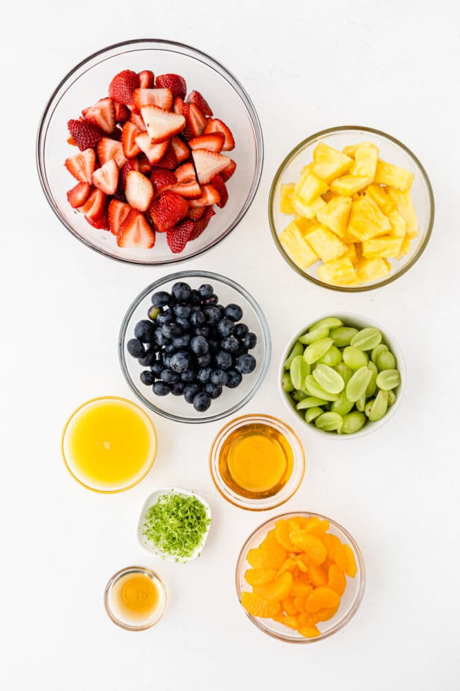 Overhead shot of all ingredients needed to make fruit salad