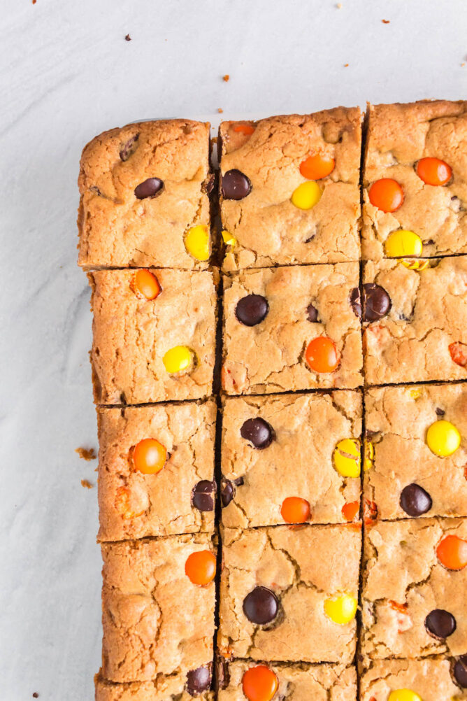 Overhead shot of loaded cookie bars cut into squares