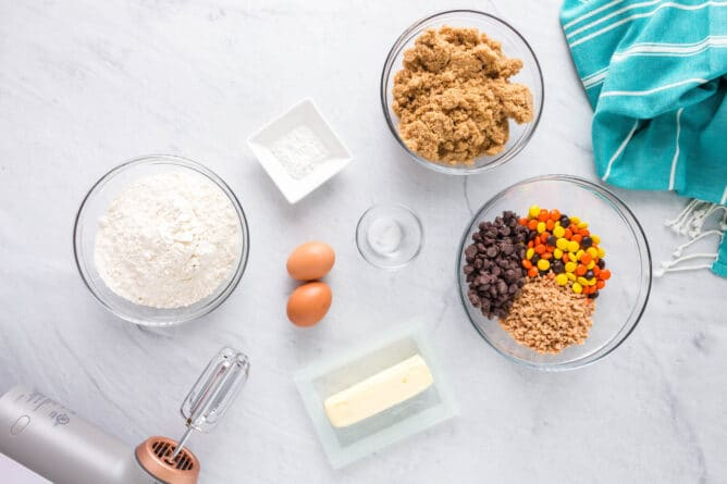 Overhead shot of all ingredients measured out needed to make loaded cookie bars