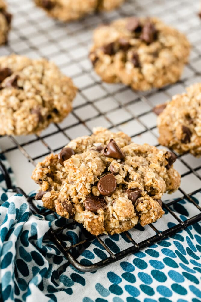 Oatmeal chocolate chip cookies on a metal cooling rack