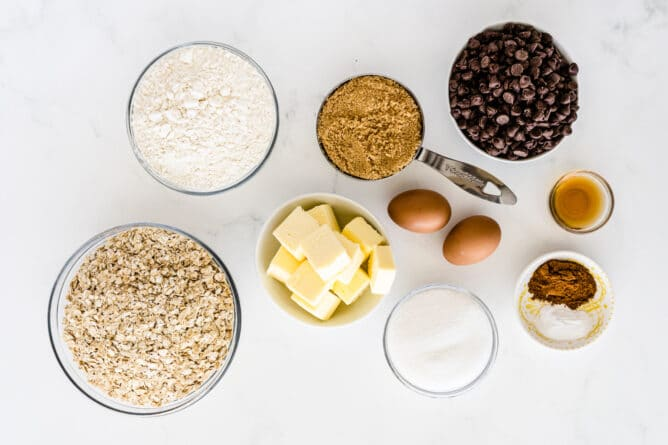 Overhead shot of all measured ingredients needed to make oatmeal chocolate chip cookies
