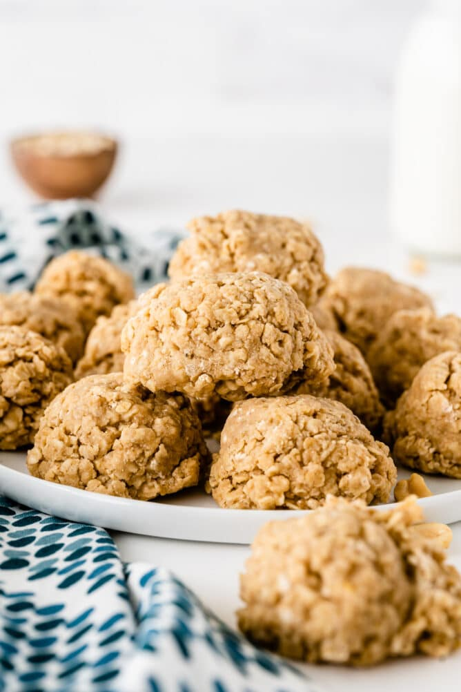 A bunch of peanut butter no bake cookies on a white plate