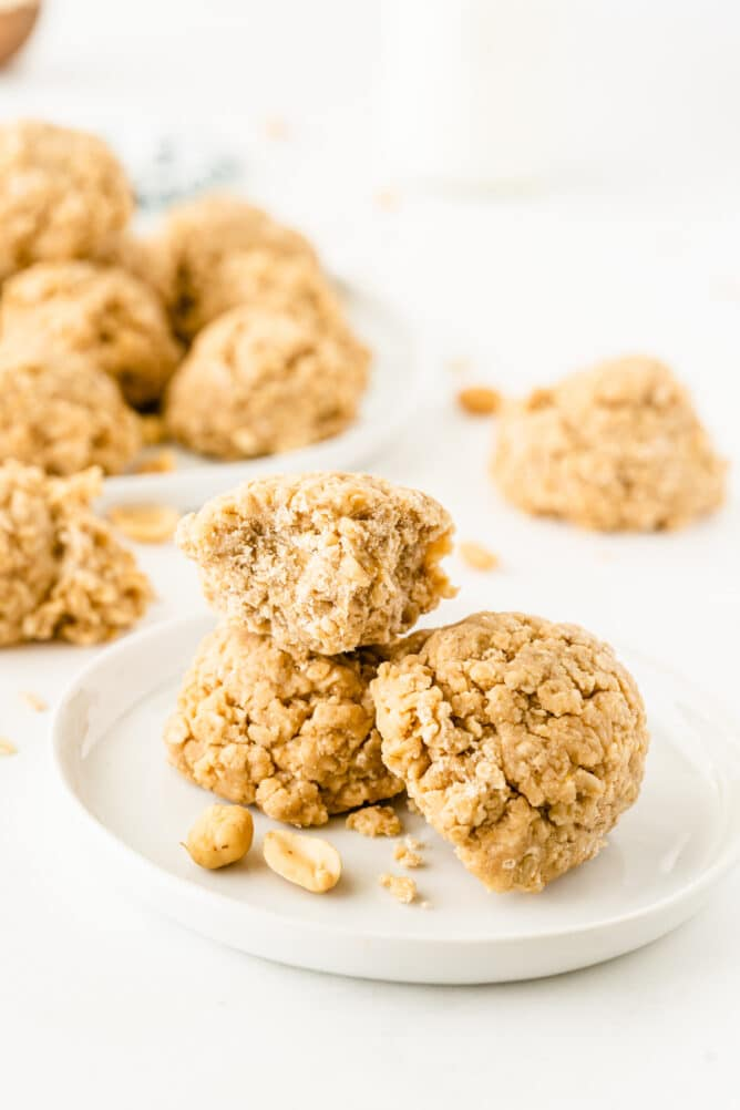 Peanut butter no bake cookies stacked on eachother on a white plate