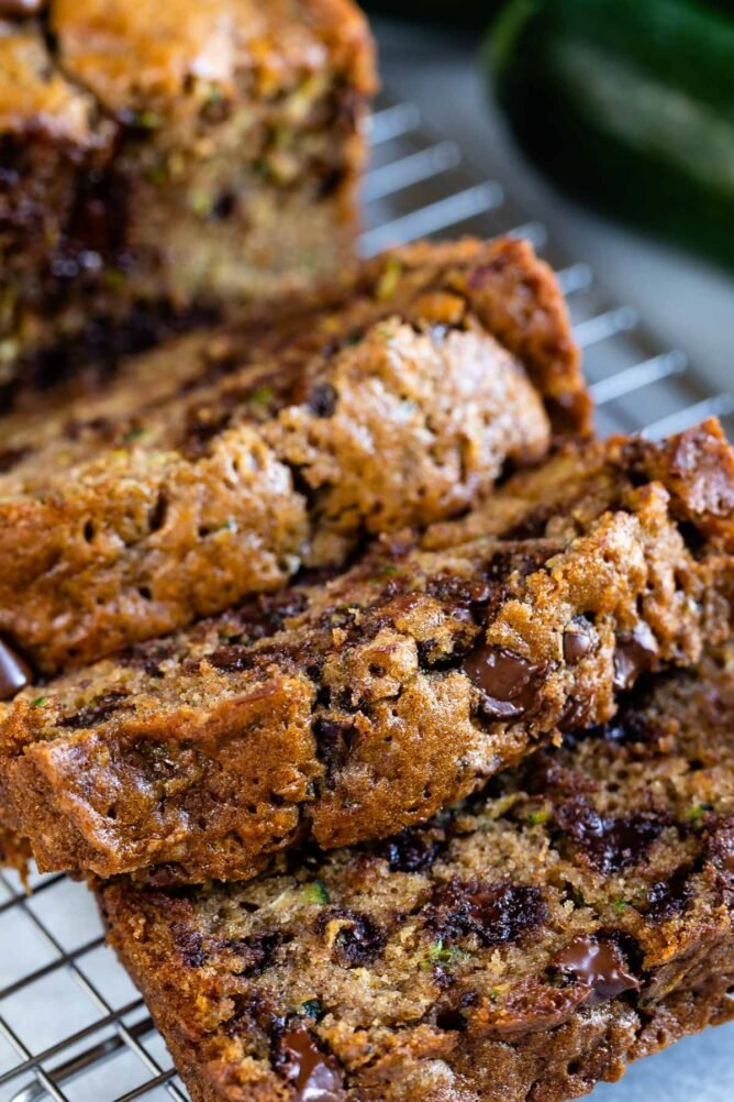 sliced zucchini bread with chocolate chips on rack