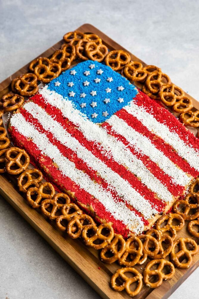 Overhead view of peanut butter flag dip with pretzels around it