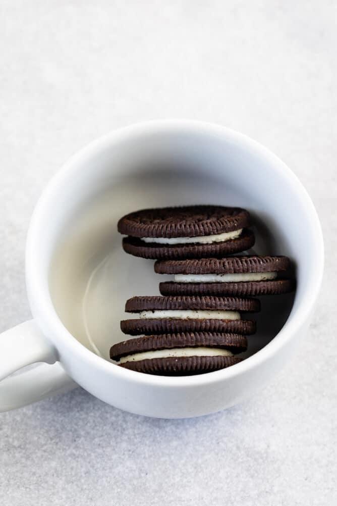 Overhead shot of 4 Oreo cookies in a mug