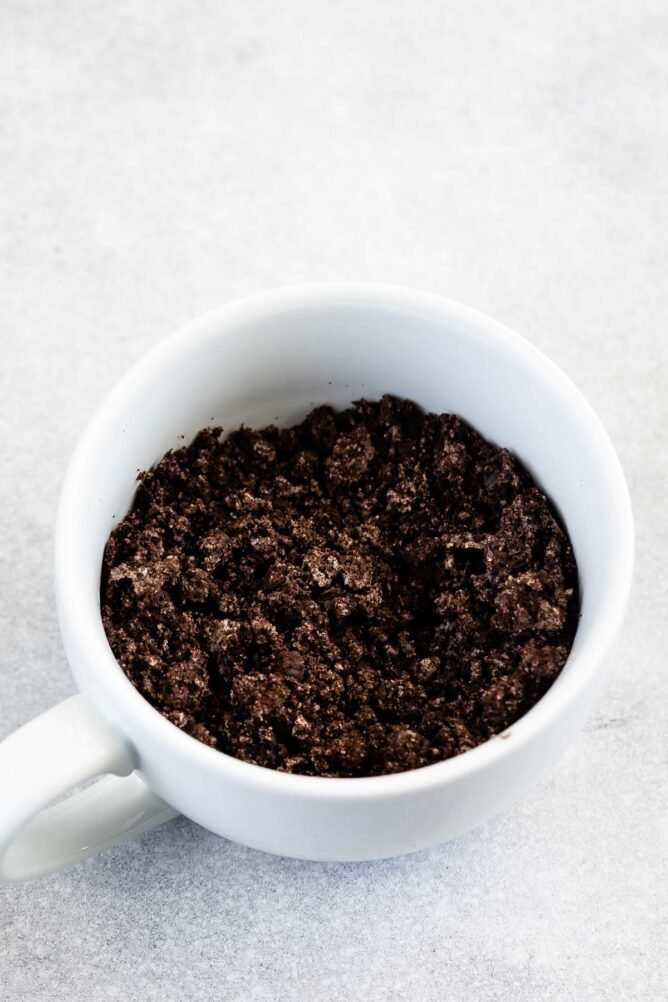 Overhead shot of crushed up Oreos in a mug