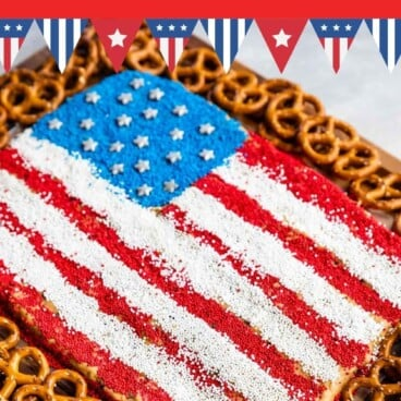 Overhead shot of peanut butter flag dip with pretzels around it and recipe title on top of image