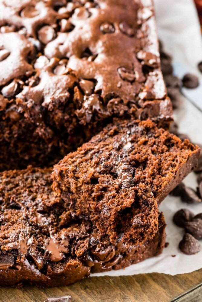 Close up of triple chocolate banana bread with end slice cut off
