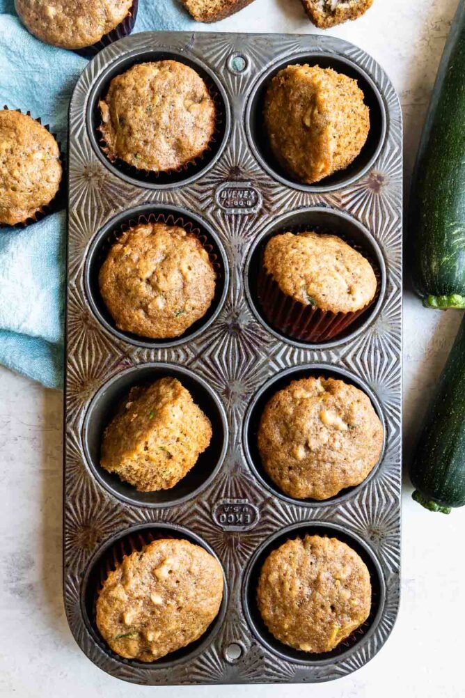 Overhead shot of zucchini muffins in muffin tin
