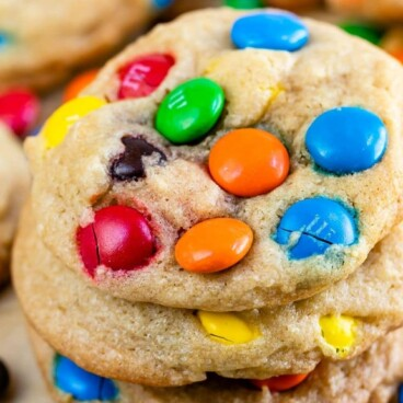 Chocolate Chip M&M Cookies stacked on top of eachother with recipe title on top of image