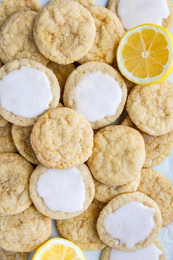Overhead shot of lemon cookies mixed with lemon slices and iced lemon cookies