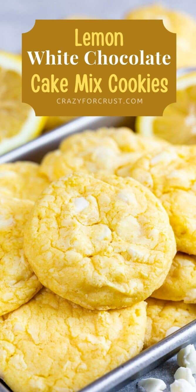 A bunch of lemon white chocolate cake mix cookies with recipe title on top of image