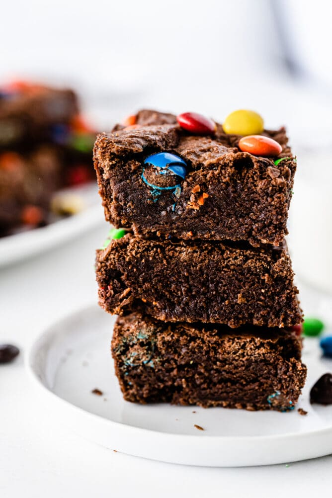 Three M&M brownies stacked on top of one another