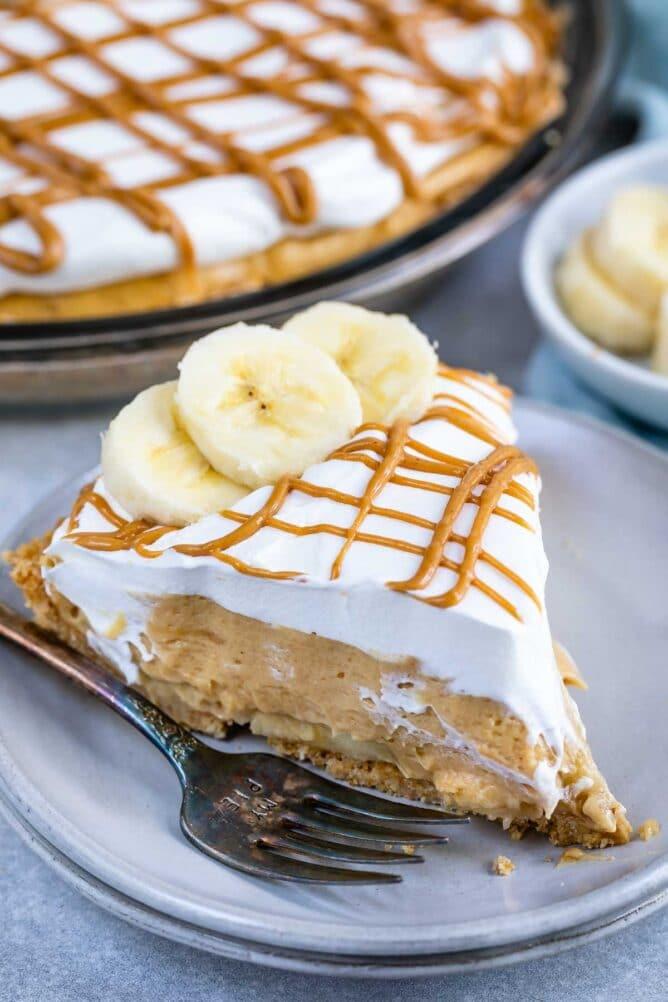 One slice of no bake peanut butter banana cream pie on plate