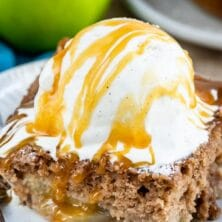 Slice of apple pie cake topped with ice cream and recipe title on top of image