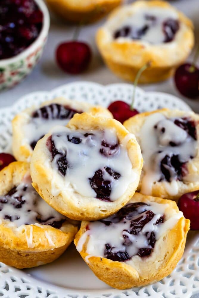 cherry pie danish with drizzle on a stack of bites