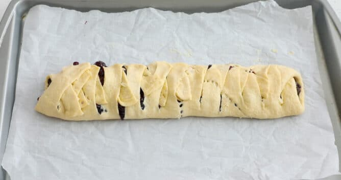 blueberry danish unbaked on cookie sheet