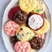 Overhead shot of a bunch of different cake mix cookies on a serving plate