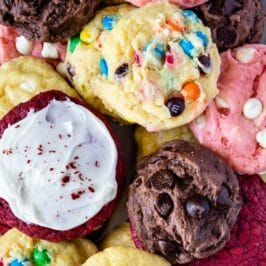 Overhead shot of a bunch of different cake mix cookies on a serving plate with recipe title on top of photo