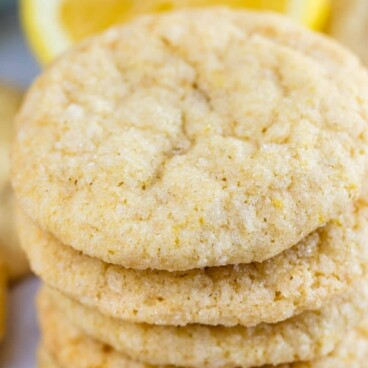 Stack of lemon cookies with recipe title on top of image