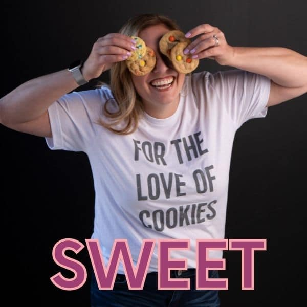woman holding cookies over eyes with shirt that says for the love of cookies
