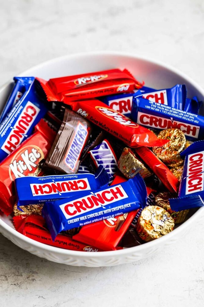 Bowl of mini chocolate candies in their wrappers