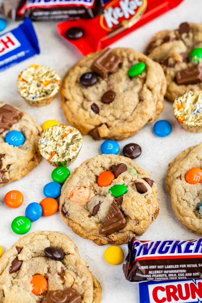 Candy bar cookies with pieces of chocolate candies all around