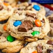 Close up shot of candy bar cookies on a metal cooling rack