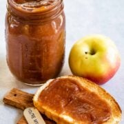 Apple butter in a mason jar and spread on a piece of toast