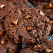 Fudgy Brownie Cookies with chocolate chips on a wire cooling rack