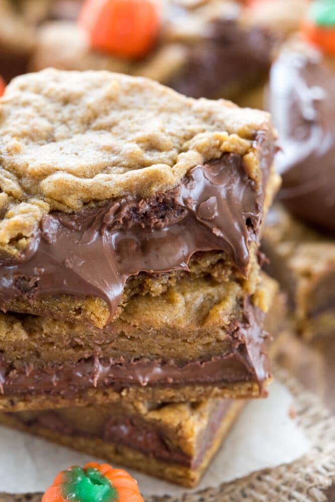 Close up shot of three pumpkin nutella cookie bars
