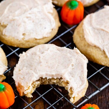pumpkin spice cookie with frosting on rack