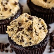 Chocolate cupcakes with cookie dough frosting and mini chocolate chips on top