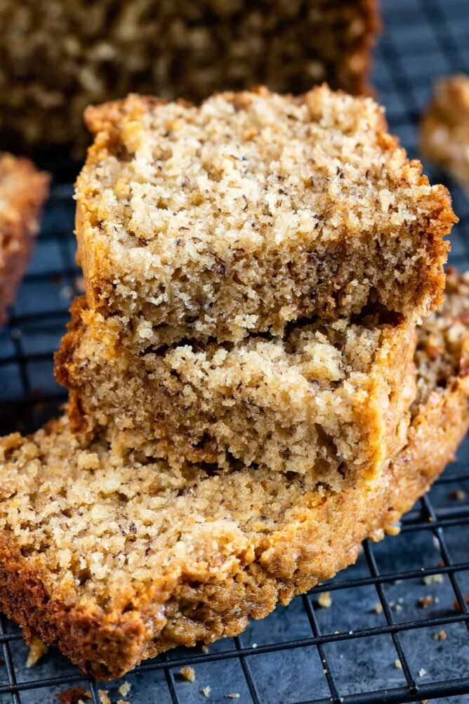 Stack of peanut butter banana bread on wire cooling rack