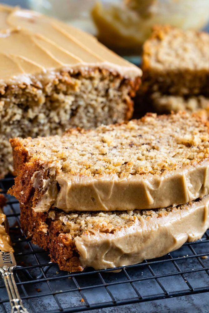 Two slices of peanut butter banana loaf bread topped with maple glaze