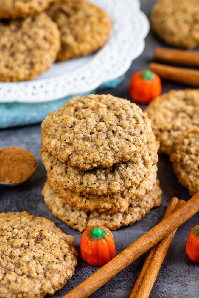 Pumpkin spice oatmeal cookies with cinnamon sticks and pumpkin candies