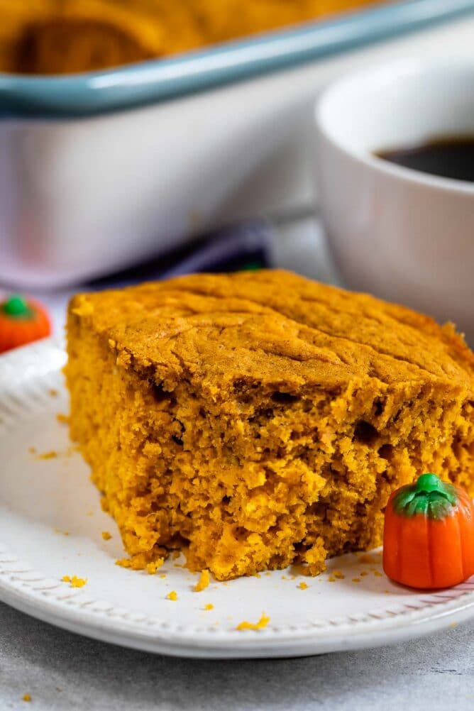 Close up shot of easy pumpkin snack cake with one bite missing